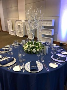 Navy is the new Black gorgeous navy linen with silver charger plates with fresh flower centerpieces with manzinta trees dripped with acrylics and tealights Gray And Navy Blue Wedding, Silver Wedding Colours, Navy Silver Wedding, Grey Wedding Decor, Blue Silver Weddings, Wedding Hire, Dream Wedding, Wedding Ideas, Silver Wedding Centerpieces