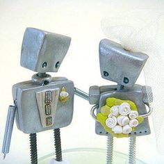 And now to go in a different direction entirely... Robot Cake Toppers