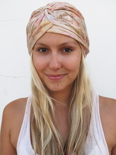 The turban: Haven't been able to make it to the hairdresser to redo those roots? No time to wash your hair before leaving the house? Ever since Kate Moss turned up at the Met Gala in 2009, turbans have been spotted from the runways of New York to the streets of Joburg! Our intern, Britney found this fabulous turban in London, which she wears over her tousled blonde locks. Why not make your own? Watch our video to find out how.
