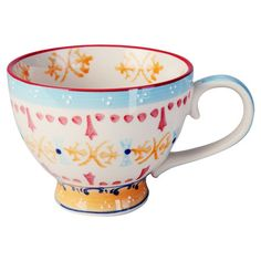Perfect for sipping a soothing chamomile or enjoying your morning java, this stoneware mug showcases painted details for artisan appeal.