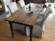 with 4 antique rosewood chairs, two upholstered, box skirted parsons chairs would look nice.