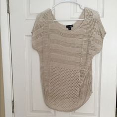 Tan Top Super cute top with holes in it! Perfect for summer. Worn a handful of times this shirt is in great condition! Please feel free to make an offer! a.n.a Tops