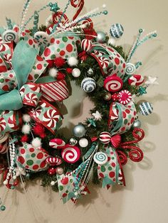 This is a beautiful Christmas Pine Wreath with Mint Green, Red & White Candy accents. Would look amazing on any door or wall. This wreath has lots of candy accents, glittery accents, Christmas ornaments and more. All on a pine wreath decorated with beautiful Mint Green, Red & White