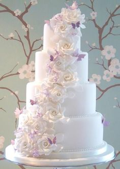 The Louise Cake with white sugar roses and lilac butterflies by Rachelle's Cakes