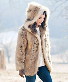 Top off your cool-weather looks with this soft and cozy faux fur coat that features a neutral hue and snuggly hood.