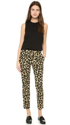 A splattered leopard print gives these EDUN pants a bold aesthetic. The slim silhouette ends with hidden-zip cuffs. Slant front pockets and welt back pockets. Hook-and-eye closures and zip fly.