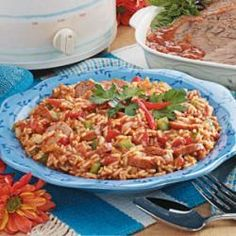 Sausage Spanish Rice- 'I'm always on the lookout for slow-cooker recipes,' writes Michelle McKay of Garden City, Michigan. 'This one couldn't be easier. It's good as a side dish, but we often enjoy it as the main course because it's so hearty.' kielbasa or Polish sausage, cans diced tomatoes, converted rice, salsa, onion, bell pepper, sweet red pepper, can diced green chiles, pkg taco seasoning Allrecipes.com