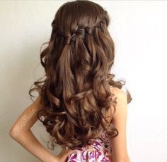 Love this hairstyle! Elegant/slightly casual...perfect for a beachy wedding :)