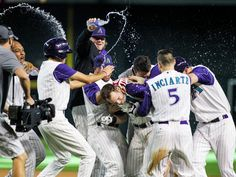 Arizona Diamondbacks second baseman Chris Owings, center, is congratulated by his teammates after hitting a single that allowed Paul Goldschmidt to score giving the Diamondbacks the 4-3 victory against the Cincinnati Reds in the 10th inning at Chase Field in Phoenix.  Isaac Hale, The Arizona Republic