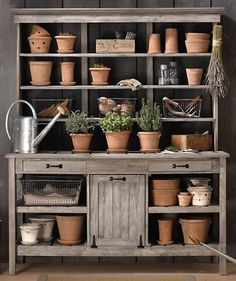 this is the cutest garden shelf...i would love, love, love to have this in the back forty...ha