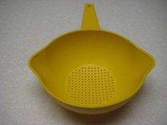 Vintage Tupperware Colander Strainer Retro Yellow--still have mine, the one that I took from my parents kitchen when I moved out. ;-)
