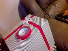Use colored masking tape instead of ribbon.  I used red for this package.