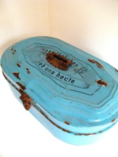 "Vintage Metal bread box from Germany. Inscription on top reads ""Unser täglich Brot gieb uns heute"", it means ""our daily bread give us today"""