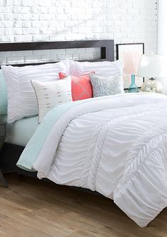 Love the New Directions® Ava Bedding Collection. The white textured comforter mixed with pop of colorful coral and gray pillows is a clean and refreshing look for the bedroom.