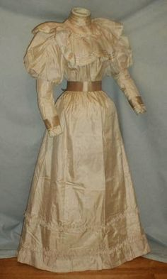 1890's Wedding Gown. A striking 1893 ivory silk wedding dress that was worn by Andora Bucher on October 5, 1893 when she married George F. Spang SR.
