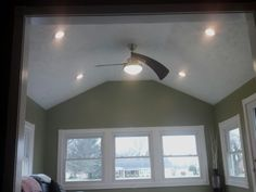 The previous sunroom had a flat 7 foot ceiling. We changed it to a vaulted ceiling making the room seem much larger!