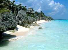 Tulum, Mexico, a walled Mayan city with cliff-side ruins along the coast of the Yucatán Peninsula