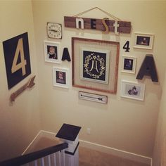 Fun staircase gallery wall - love the use of numbers and letters and mismatched frames eclecticallyvintage.com