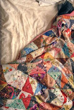 Triangle #scrapquilt. Instead of classic quilting, tie using embroidery floss for a fun alternative.