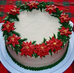 - I made this cake as a my contribution to the dessert table at my husband's family potluck for Christmas Day. All decoration is piped in buttercream. I sprinkled a tiny bit of gold hologram dust over the poinsettias for a glittery effect. Christmas Cake Designs, Christmas Cake Decorations, Christmas Cupcakes, Christmas Sweets, Holiday Cakes, Xmas Cakes, Christmas Christmas, Christmas Wedding, Cake Decorating Tips