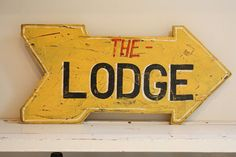 Wonderful Vintage directional THE LODGE sign by mysweetsavannah; already sold!  <3