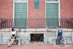 Couple posing candidly for engagement photos in Old Town Alexandria