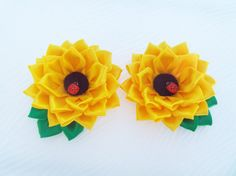 Kanzashi fabric flowers from sunflowers.Set of 2 hair clips.Accessories for girls.Yellow  Flowers made of satin ribbons in the technique of kanzashi. Sunflowers flowers are attached to hair clips.  About 9 cm ( 3.54 ) in diameter. The price is for 2 pieces.  Some colors may vary due to computer screen.  Please contact me with any questions you may have.  My fabric flowers can be the gift for your family and friends!   To see more hair clips, please visit my store: https://www.etsy....