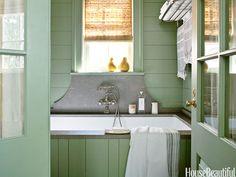 A bathtub with a Lagos Azul limestone backsplash. Design: Bill Ingram. housebeautiful.com. #bathtub #bathroom