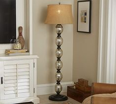 """Stacked Mercury Glass Floor Lamp Base #potterybarn 13"""" diameter, 63.5"""" high Crafted of antiqued mercury glass and bronze-finished aluminum. On/off switch on socket."""