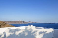 The Concept: Private sanctuary At the entrance to Oia village in the northern most village of Santorini, the villa welcomes guests to a world of exqui. Oia Greece, Santorini Villas, Luxury Villa, Island, Travel, Blue, Collection, Greece, Luxury Condo