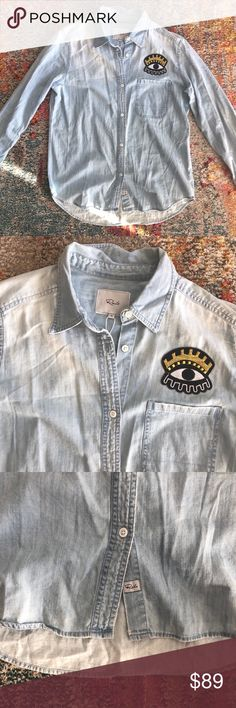 """Rails Chambray Button Down New with tags, """"watchful 👁"""" patch above left chest pocket. Light denim wash 👖 I'm A Top Rated & Top 10% Seller!!! 🎊🥂🎉 NO TRADES please but all FAIR OFFERS are welcome! Will bundle with another item from my closet (2 or more items = a bundle!) for best deal ✌🏻 Follow me on insta @thegracekellie for more looks 💕 Rails Tops"""