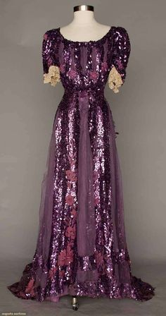 Late 1890s Purple Paillette Gown Irregularly shaped paillettes embroidered floral motif on chiffon; lace cuffs