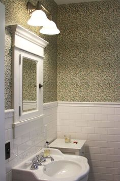 A California Craftsman on Apartment Therapy (here: William Morris wallpaper in the bathroom) So simple and lovely. Craftsman Style Bathrooms, Bungalow Bathroom, Craftsman Interior, Craftsman Bungalows, Bathroom Renos, Downstairs Bathroom, Craftsman Houses, Gold Bathroom, Craftsman Bathroom Mirrors