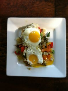 pretty sure this is dinner tonight - sauteed veggies (green beans, carrots, onion, red pepper, greens) with eggs and black beans