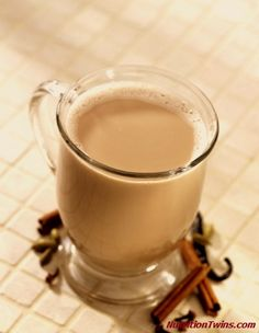 Place 2 tea bags, 1 tsp cinnamon, 1/2 tsp ginger, 1/4 tsp allspice in coffee filter, brew 1 cup water, add 1 cup milk to brewed tea.