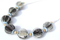 Canaletto Bead Necklace by Liz Hamman  -  Necklace made using pages from a book on Canaletto with wooden beads and pale (Canaletto) blue buttons strung on a hand made macramé cord with button and loop closure. Light spray varnish gives some protection. Each bead measures 3cm approx diameter. Total length end to end is 53cm.