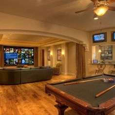like the idea of making the game room and media room one big room but maybe pocket door dividers instead of a curtain