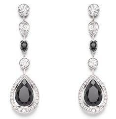 Piaget Couture Précieuse earrings Radiant Laces Inspiration in 18K white gold set with 4 pear-shaped black spinels (approx. 6.52 cts), 60 brilliant-cut diamonds (approx.1.18 cts), and 2 pear-shaped diamonds (approx.0.49 ct).