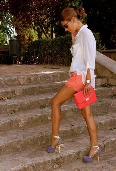 Beautiful colors. Love the loose-fitted top with the coral short shorts. Everything works great with the purple and gold pumps.