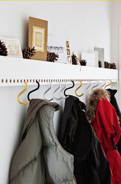 clever system of holes and s-hooks as hangers on mantle