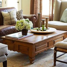 Homespun Style...leather furniture, tan accent chair, pops of blue and green, love!