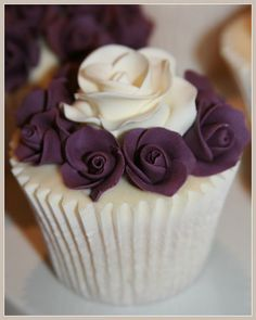 Wedding Show Cupcakes. All vanilla cupcakes, via Flickr. Purple and ivory