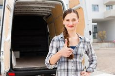 Woman in front of moving truck. Young woman in front of moving truck, the van is , Long Distance Movers, Royalty Free Stock Photos, Men Casual, Trucks, The Originals, People, Mens Tops, Storage, Vectors