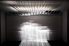 Resonance  The kinetic installation is made of light, movement and a mirrored body. Its everchanging multiplexed pattern of movement is literally coded in hardware. The abstract, moving light architecture merges with, expands, and adds a new dynamic to the actual physical space.