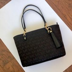 f56a85a32d4c Shop Women s Michael Kors Black Gold size OS Totes at a discounted price at  Poshmark.
