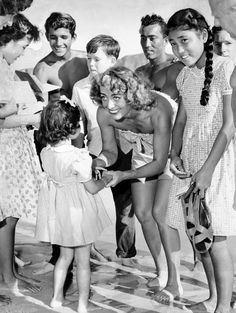 Joan Crawford greeting fans on vacation in Hawaii, 1947
