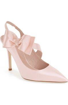 A gorgeous oversize bow and an angled arch strap define this pointy-toe pump by Kate Spade finished in lustrous pink satin.