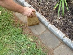 Edging a Flower Bed With Cement Pavers - less weedeating