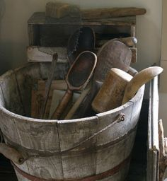Primitive old wood bucket. I love the wooden utensils. I have started a collection.
