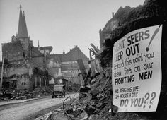 """""""Sight seers! Keep out! Beyond this point you draw fire on our fighting men. He risks he life 24 hours a day. Do you??"""" (Cologne, Germany, 1945)  Margaret Bourke-White—The LIFE Picture Collection/Getty Images"""